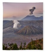 sunrise at vulcano Bromo with sea of sand vulcano Semeru with eruption Java Indonesia Fleece Blanket
