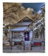 The Decorated Little House In The Snow Fleece Blanket
