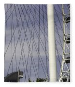 The Top Section Of The Marina Bay Sands As Seen Through The Spokes Of The Singapore Flyer Fleece Blanket