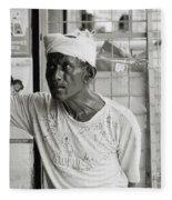 The Worker In Cochin Fleece Blanket
