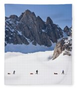 Three People Ski-tour On Karale Glacier Fleece Blanket