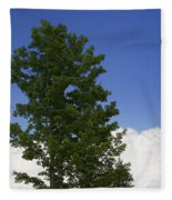 Tree Against A Cloudy Blue Sky In Vermont Fleece Blanket