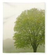 Tree In Fog Fleece Blanket