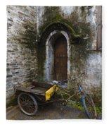 Tricycle Parked In Alleyway Fleece Blanket