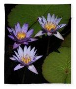 Trio Of Purple Water Lilies Fleece Blanket