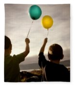 Two Children With Balloons Fleece Blanket