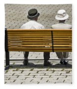 Two People Seated On A Bench Fleece Blanket