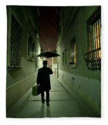 Victorian Man With Top Hat Carrying A Suitcase And Umbrella Walking In The Narrow Street At Night Fleece Blanket
