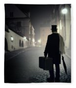 Victorian Man With Top Hat Carrying A Suitcase Walking In The Old Town At Night Fleece Blanket