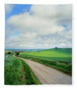 View Of Road Passing Through A Field Fleece Blanket