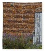 White Door In Brick Building Fleece Blanket