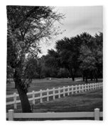 White Fence On The Wooded Green Fleece Blanket