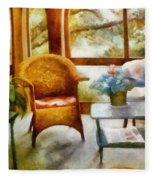 Wicker Chair And Cyclamen Fleece Blanket