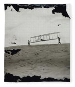 The Wright Brothers Wilbur In Motion At Left Holding One End Of Glider Fleece Blanket