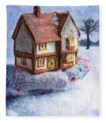 Winter Cottage In Gloved Hand Fleece Blanket