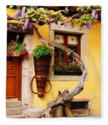 Wisteria And Yellow Wall In Alsace France Fleece Blanket