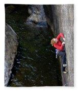 Woman Climbing Above A River Fleece Blanket
