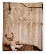Worn Teddy Bear On Brass Bed Fleece Blanket