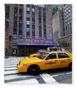 Yellow Cabs Pass In Front Of Radio City Music Hall Fleece Blanket