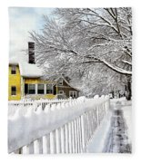 Yellow House With Snow Covered Picket Fence Fleece Blanket