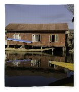 Yellow Shikara In Front Of A Run Down Area Of Houses In The Dal Lake Fleece Blanket
