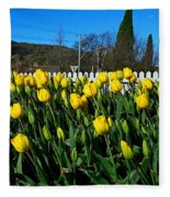Yellow Tulips Before White Picket Fence Fleece Blanket