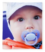 Young Baby Boy With A Dummy In His Mouth Outdoors Fleece Blanket