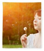 Young Beautiful Woman Blowing A Dandelion In Spring Scenery Fleece Blanket