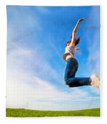 Young Beautiful Woman Jumping For Joy Fleece Blanket