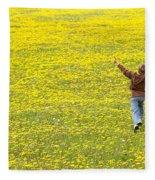 Young Boy Running Through Field Of Fleece Blanket