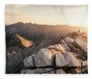 Young Man Scrambles To The Summit Fleece Blanket