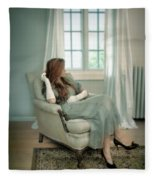 Young Woman In A Chair Fleece Blanket