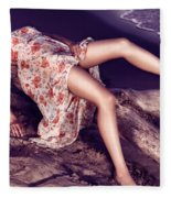 Young Woman In Dress Lying On Driftwood On A Shore Fleece Blanket