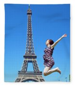 Young Woman Jumping Against Eiffel Tower Fleece Blanket