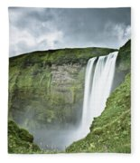 A Waterfall Over A Grassy Cliff Fleece Blanket