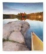 Canoe At A Rocky Shore Autumn Nature Scenery Fleece Blanket