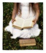 Girl Is Reading A Book Fleece Blanket