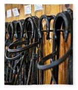 Horse Bridles Hanging In Stable Fleece Blanket