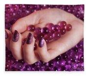 Woman Hand With Purple Nail Polish On Candy Fleece Blanket