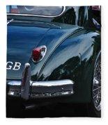 1956 Jaguar Xk 140 - Rear And Emblem Fleece Blanket