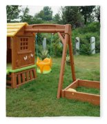 A Childs Playing Equipment In A Green Location Fleece Blanket