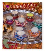 A Decorated Hindu Prayer Thaali With Wax Candles Oil Lamps Fleece Blanket