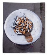 A Lot Of Cigarettes Stubbed Out At A Garbage Bin Fleece Blanket