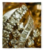 A White Gold Bracelet Among Other Yellow Gold Jewellery Fleece Blanket