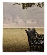 A Wrought Iron Black Metal Bench Under A Tree In The Qutub Minar Compound Fleece Blanket