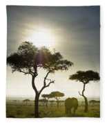 An Elephant Walks Among The Trees Kenya Fleece Blanket