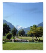 An Open Field In Interlaken With A View Of The Mountains In The Background Fleece Blanket