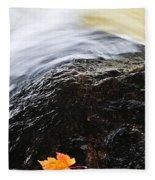 Autumn Leaf On River Rock Fleece Blanket