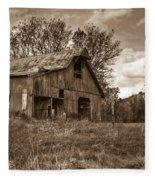 Barn In Turbulent Sky Fleece Blanket