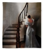 Beautiful Young Woman Standing In Gown By Stairs Fleece Blanket